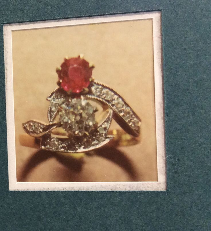 Ruby and diamond antique replica ring remodelled using original stones in a cross over design with leaf pattern and fine pave milling detail around the diamonds
