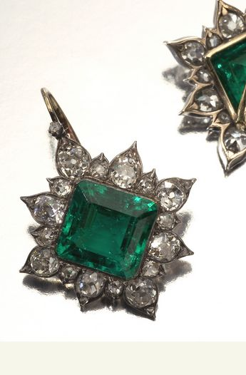 PAIR OF EMERALD AND DIAMOND EARRINGS, CIRCA 1880 Each of stylised star design collet-set to the centre with a square step-cut emerald within a border of old mine and rose-cut diamonds.