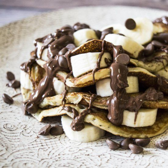 Super Easy-To-Make Pancake Stack draped in Smooth Nutella, Chocolate Chips and Banana. Happy Pancake Day!