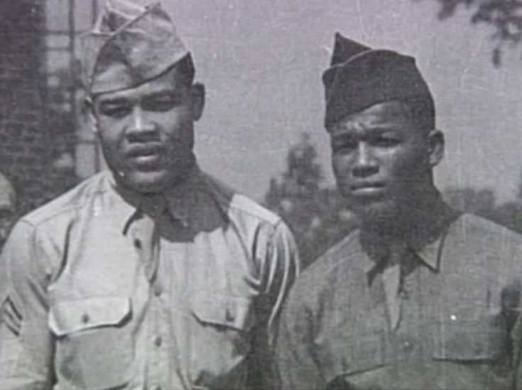 Joe Louis and Sugar Ray Robinson in their military attire. These are boxing legends.