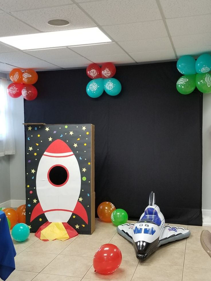 Rocket Photo booth and inflatable space ship. Birthday decoration outer space theme party