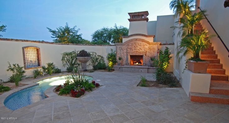 Enclosed Southwest design courtyard patio with outdoor fireplace