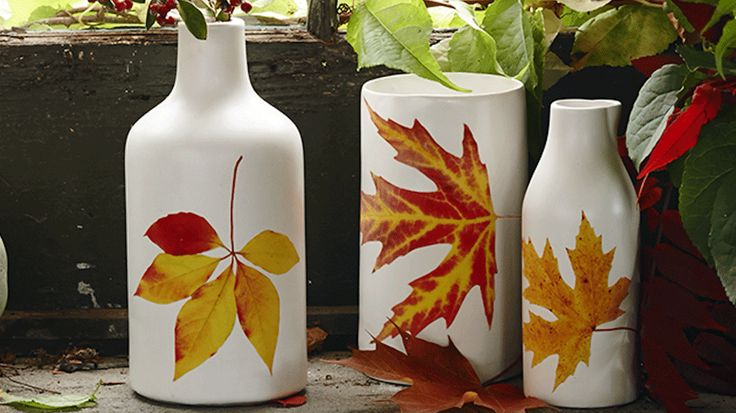 Create a pretty fall vase in minutes! On decal paper, print and cut out leaf forms. Soak in water for 30 seconds. Peel off the backing of the paper, and stick the decal to the vase. Smooth out any air bubbles with a cloth, and display.