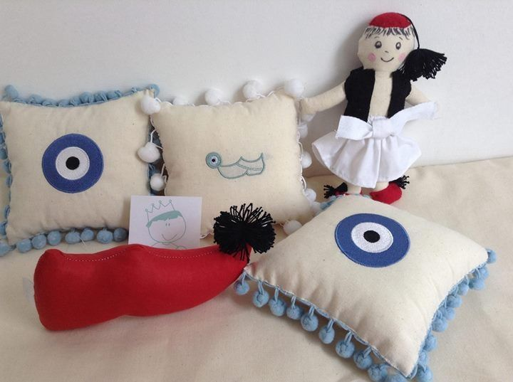 its all Greek to me. Cushion and doll.