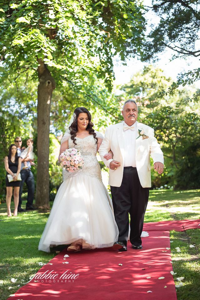 Walking down the aisle at Ascot House Receptions