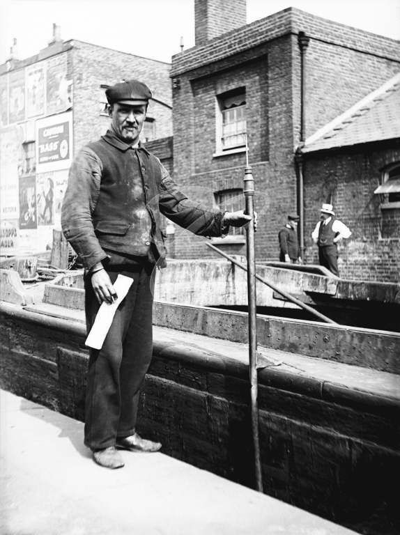 Toll Clerk gauging a barge on the canal in London. c1905.....Pip wasn't happy to have her boats gauged!