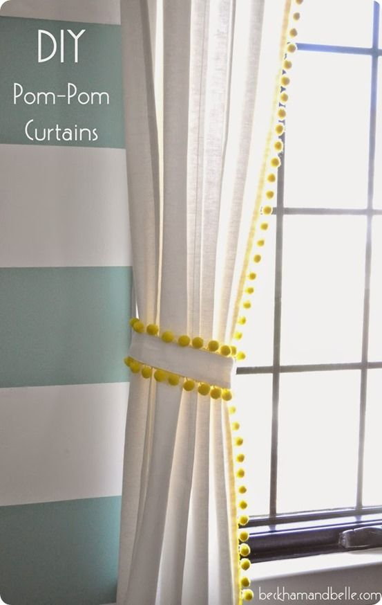 Neon yellow trim with dangling pom-poms adds texture and serious fun factor to all-white curtains.