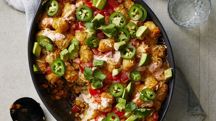 Tex-Mex meets tater tots in this easy, inexpensive, and all-around comforting one-dish dinner. Our spicy twist on the classic tater tot casserole consists of a succulent ground beef filling—featuring creamy black beans, crisp-sweet corn, cheese, and mild green chiles for a kick—topped with crispy tater tots, and finished with a drizzle of an addictively spicy and tangy sour cream sauce. Top this fiesta of a casserole with fresh garnishes, such as avocado, tomato, jalapeño, and cilantro, and…