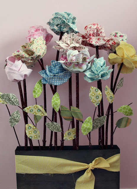 Long Stemmed Fabric Roses: Tutorial. I think this could be easily modified to work with a jelly roll.
