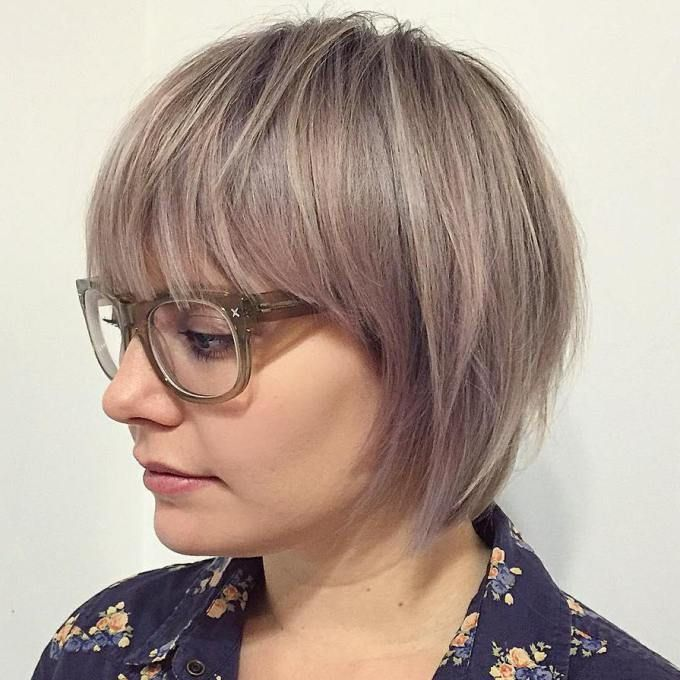 Ash Blonde Layered Bob With Bangs                                                                                                                                                                                 More