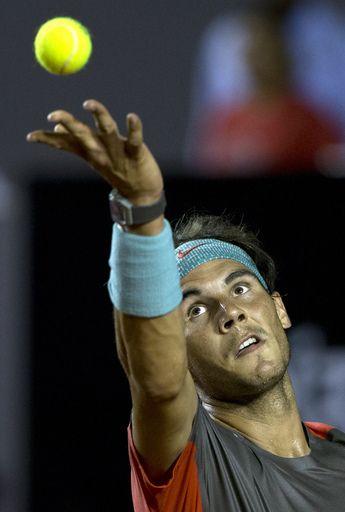 Rafael Nadal of Spain serves to Albert Montanes of Spain at the Rio Open tennis tournament in Rio de Janeiro, Brazil, Thursday, Feb. 20, 2014. (AP)