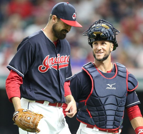 Cleveland Indians catcher Yan Gomes congratulates relief pitcher Andrew Miller after completing the eighth inning against the Detroit Tigers, July 8, 2017, at Progressive Field.Indians won 4-0