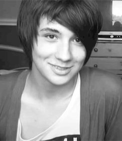 danisnotonfire on youtube. yea i ruined my life but he's so funny and sarcastic and cute and dimples