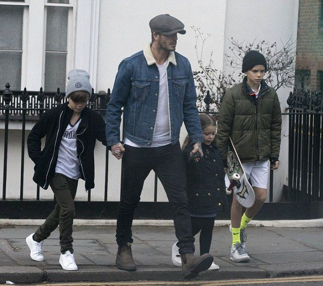 Family ties: David Beckham proved his 'daddy cool' credentials when he stepped out with ch...