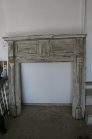Distressed mantle for our fireplace