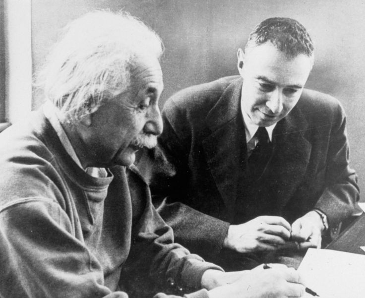 Albert Einstein: Albert Einstein sits with fellow physicist J. Robert Oppenheimer who followed in his footsteps and took over as senior professor at the Princeton Institute for Advanced Study a few years after Einstein resigned. (Photo:  CORBIS)