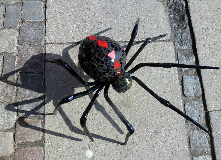 Black Widow Spider. Glass mosaic on styropor and mortar and iron legs