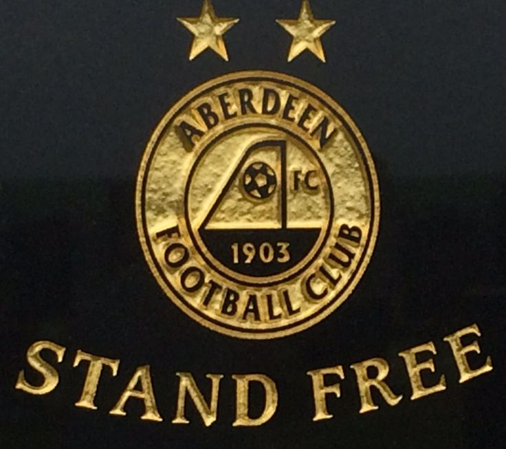 A tribute paid to an Aberdeen F. C. Football fan who had the clubs badge and slogan carved on his memorial.