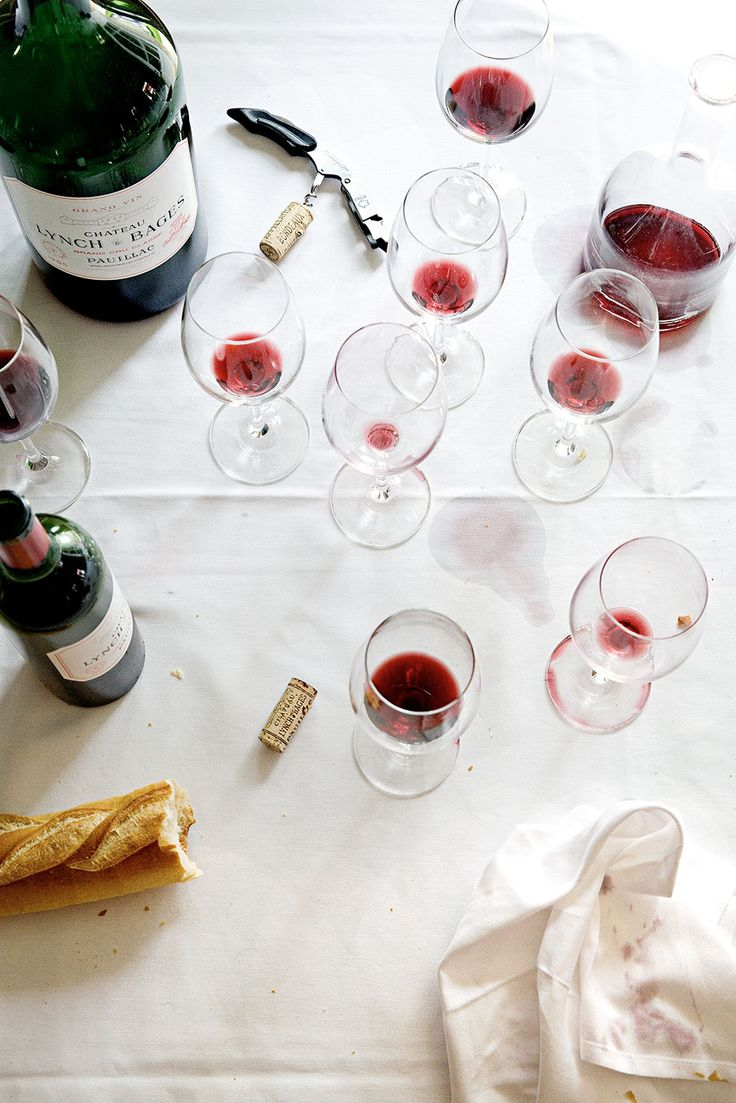 A table at Café Lavinal, in Pauillac, filled with wine from the local Château Lynch-Bages