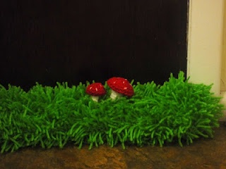 Mushroom Door Draft Blocker.  pattern for mushrooms and an explanation for grass. Genius and adorable!