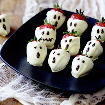 Ghostly Strawberries - i wonder if white candy melts and black frosting would work as well? have a chocolate allergy in family.