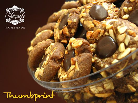 Chocolate thumbprint cookies, with chopped cashew nuts and chocolate.