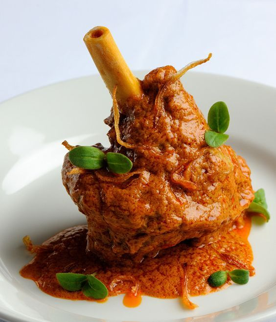 Alfred Prasad's lamb shanks recipe slow-cooks the meat with browned onions…