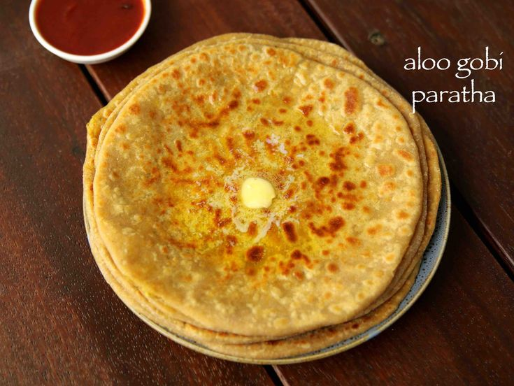 aloo gobi paratha recipe, aloo gobi ke parathe, alu gobi paratha with step by step photo and video recipe. basically a indian flat bread recipe stuffed with mixed vegetables stuffing. a fusion of paratha recipe with a combination of potatoes and cauliflower stuffing within the paratha.