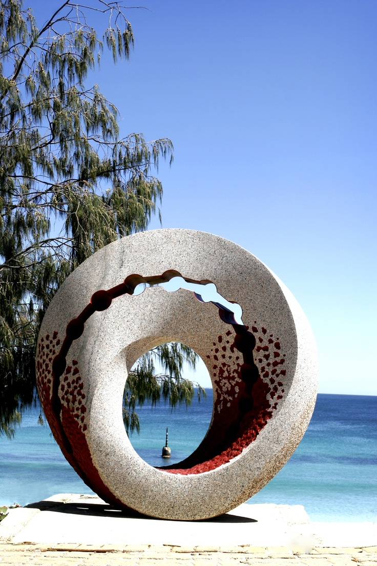 Mobius in Space by Keizo Ushio This sculpture carved from a solid piece of granite is beautifully crafted with a highly polished finish highlighted with the use of Japanese red ochre.