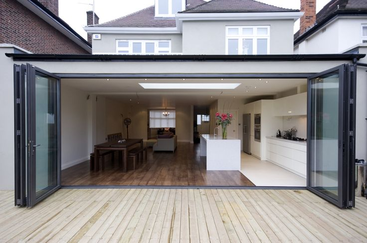 Light and spacious extension design using a wide opening coupled with a skylight.