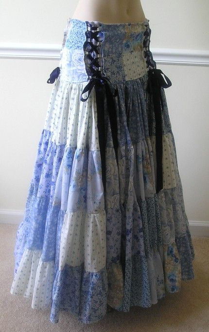Blue patchwork with ribbon skirt. Although methinks I'd put the bows up near where I want the skirt narrowest... Y'know, assuming they're meant to be functional.