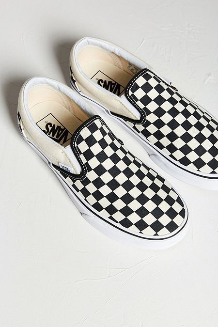 19b926ee6e9479 Vans Classic Black and Cream Checkerboard Slip-On Trainers
