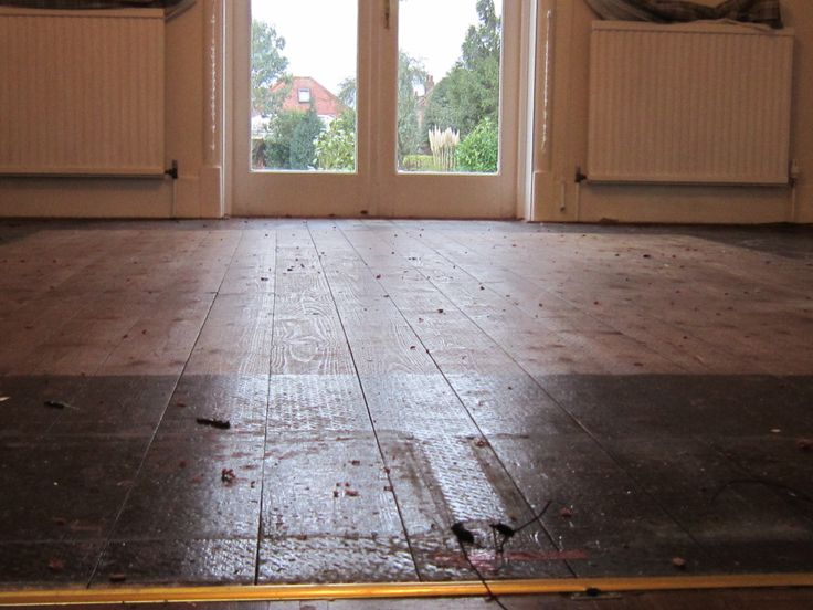 Before with all old varnish embedded into the wooden floor surface