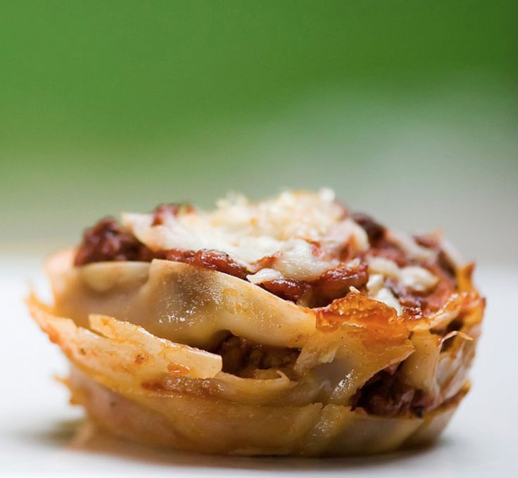 This lasagna cupcakes recipe uses tomato sauce, ricotta cheese and mozzarella and turns them into one bite-size piece of deliciousness.