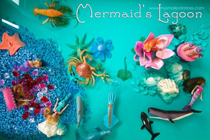 Mermaid lagoon sensory bin with water. How much fun does this look?