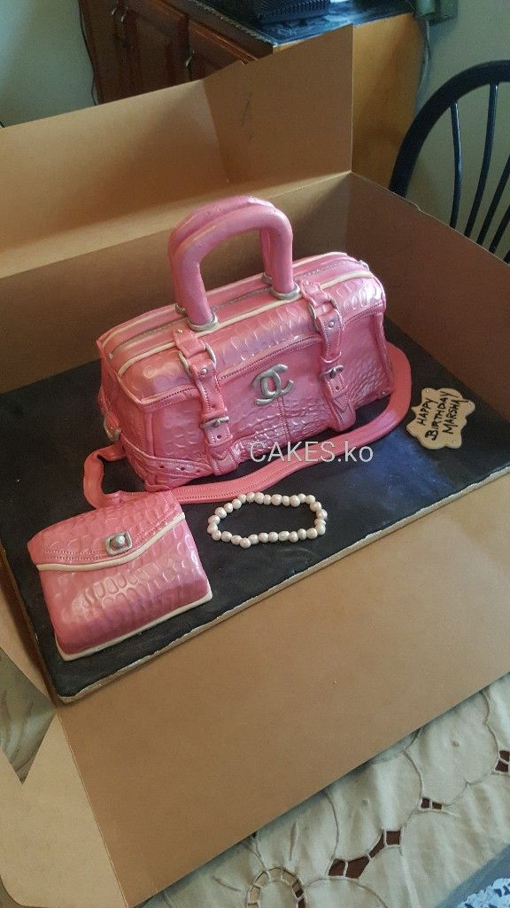 Did this pink handbag cake and matching clutch purse cake for a lovely for her birthday. Click link to my business page for more of my work.
