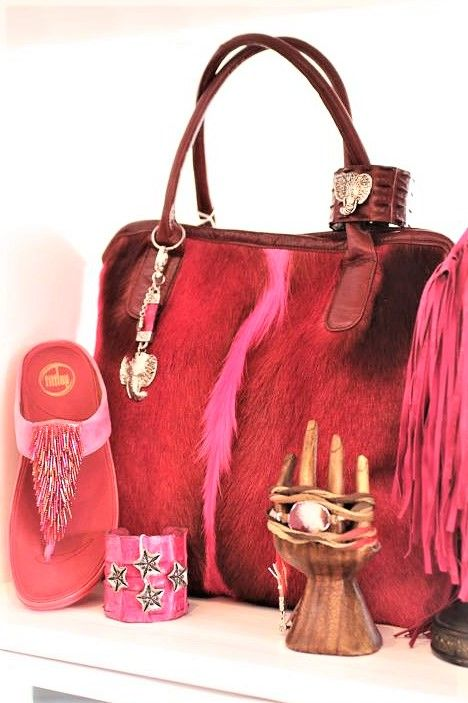 SPOTTED IN MIA AFRICA BOUTIQUE PINK SPRINGBOK TOTE WITH LEATHER FRINGED SCARF AND CUFF BY UG-LEE.