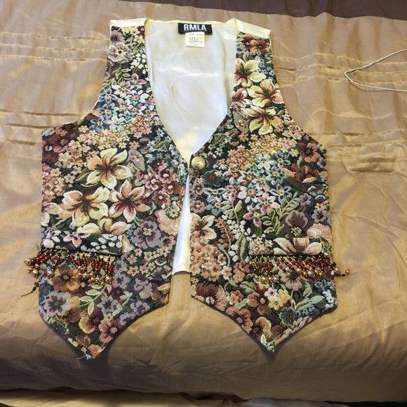 This is a vintage flower bomb vest  Flower bomb vest,  with a sheer back tie up Vintage Jackets & Coats Vests