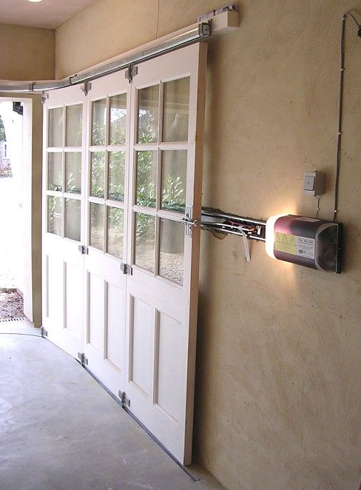 I love these sliding garage doors! To prevent blocking any ceiling room or light.