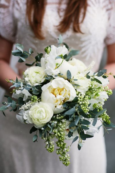White peonies ranunculus and eucalyptus wedding bouquet