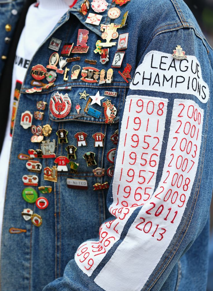 This fan shows his passion for Manchester United in vintage style with a classic badged up denim jacket.
