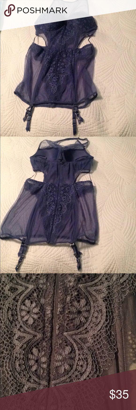 Victoria's Secret sexy corset Victoria's Secret very sexy net & lace corset with garters. Ready for Valentines fun. Size 36C. NWOT. Blue/ gray color. Victoria's Secret Intimates & Sleepwear