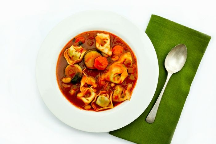 This recipe makes a big pot of minestrone soup made with courgette (zucchini), carrot, spinach and cannellini beans. The special finishing touch which makes this soup a filling meal is parcels of spinach and ricotta tortellini. Change the tortellini for any other unfilled pasta shape to make this recipe vegan.