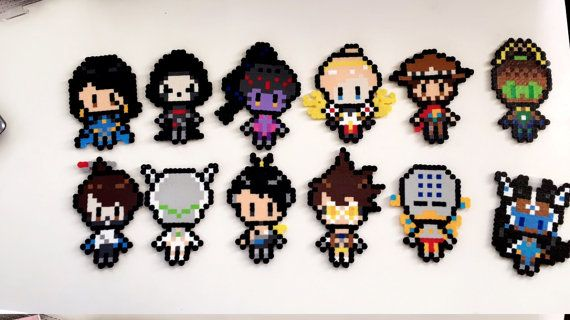 A perler bead sprite based on several overwatch champs. They are around 7 inches by 5 inches, depending on the design. Feel free to message me for any custom orders =]  I ship within two days unless it is a weekend or holiday.  Can add on magnets for free.