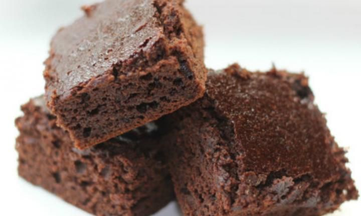 Dark and rich, moist and fluffy, this chocolate brownie is amazing. Oh, and did I mention it's healthy? These brownies have half the sweetener, only a smidge of butter and pumpkin for moisture.
