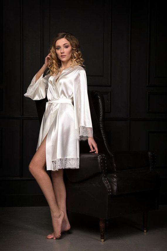 This gorgeous lace robe for bride is made of ivory stretch satin. The  sleeves are wide and trimmed with white Chantilly lace as well as the hem. 3e073e208