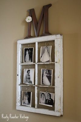 Chippy shabby window photo display: Reclaimed pained window frame with chicken wire as backing and photos attached with photo clips.