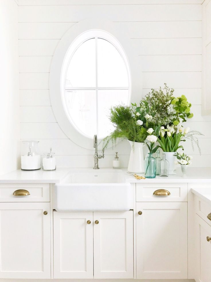 Crisp White Laundry Room Filled With Green And White