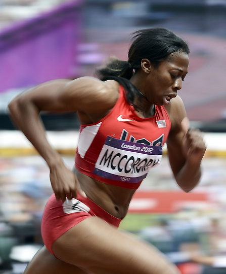 USA Francena McCorory shoots out of the block in the women's 400m round 1 during track & field at Olympic Stadium Friday, August 3, 2011