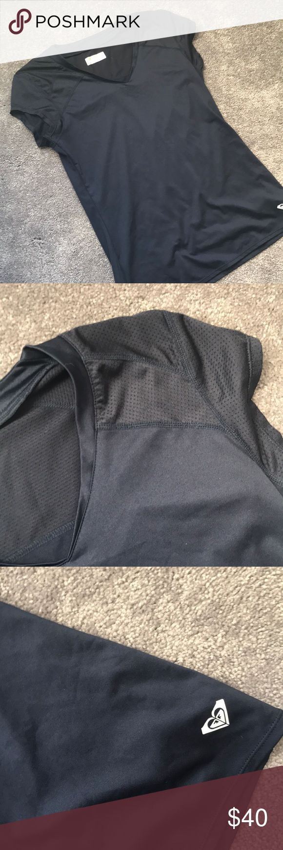 Roxy Athletic Shirt Navy blue athletic shirt. 90% poly, 10% spandex. Roxy Tops Tees - Short Sleeve